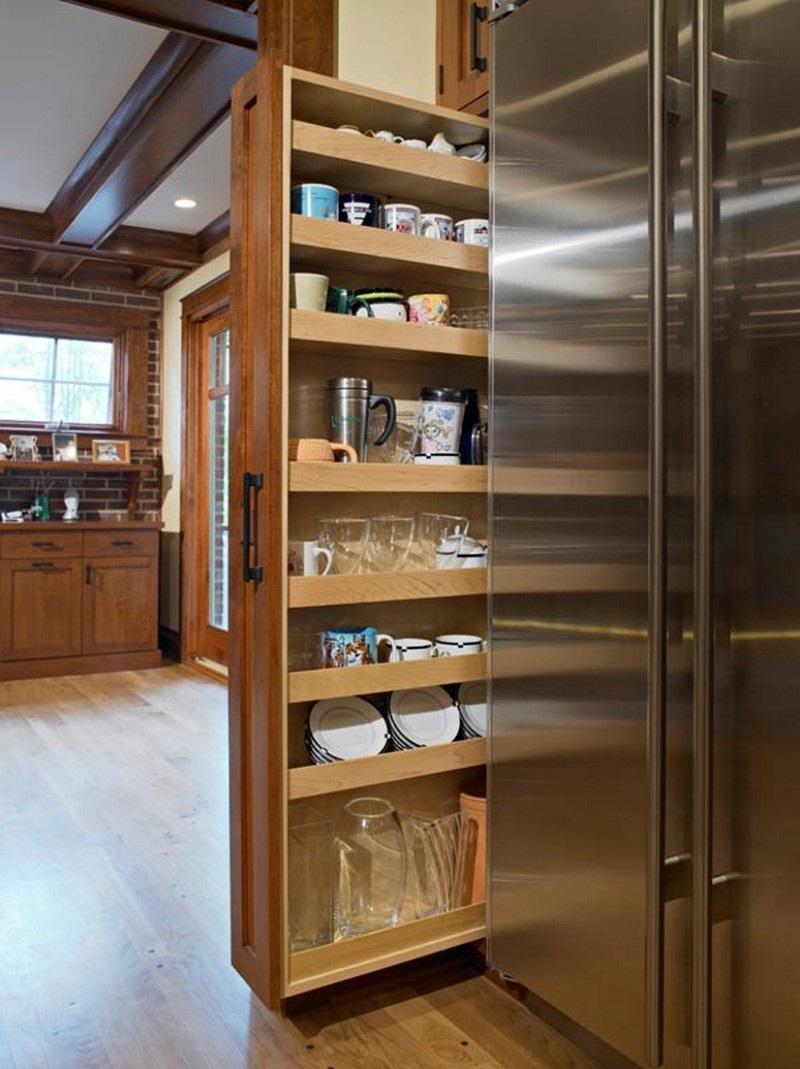 Прикрепив пластиковую трубу внутри кухонного ящика, ты получишь дополнительное место для хранения бутылок с бытовой химией. как упорядочить вещи на кухне Зачастую возле холодильника остается еще много свободного пространства. Используй его с толком, смастери вертикальный выдвижной ящик! как упорядочить вещи на кухне Раздвижной стол — полезная идея, которая поможет получить дополнительную столешницу на кухне. как навести порядок на кухне Специальные сиденья помогут сэкономить пространство на кухне. Такую мебель можно сделать на заказ.