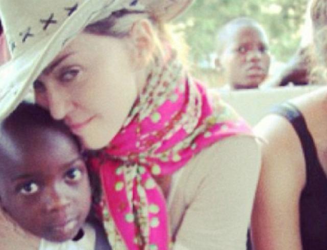 Мадонна планирует усыновление ребенка?